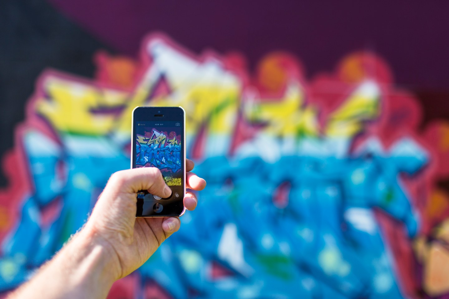 https://www.pexels.com/photo/iphone-smartphone-taking-photo-graffiti-4641/