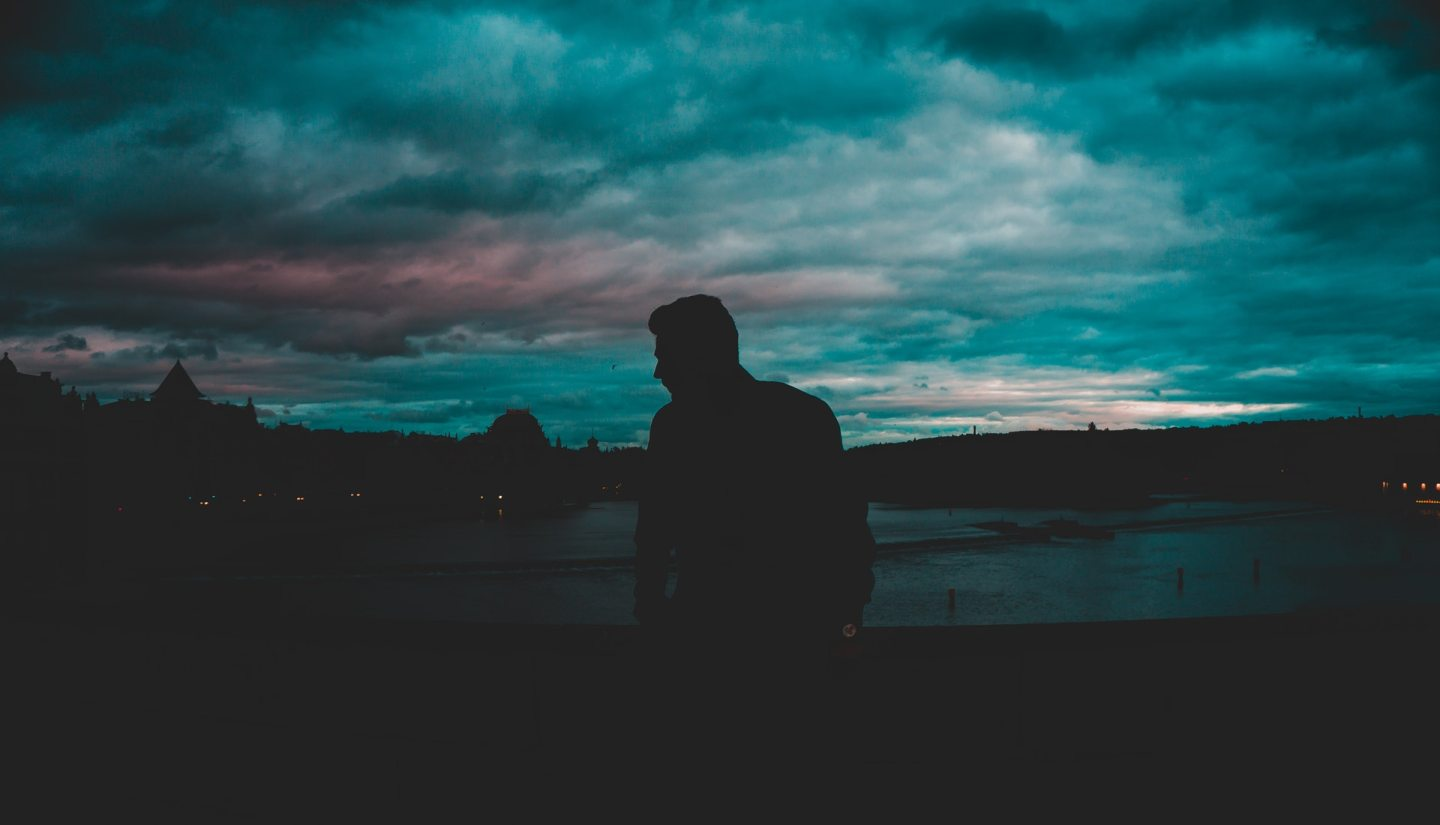 https://www.pexels.com/photo/man-silhouette-near-body-of-water-at-nighttime-667136/